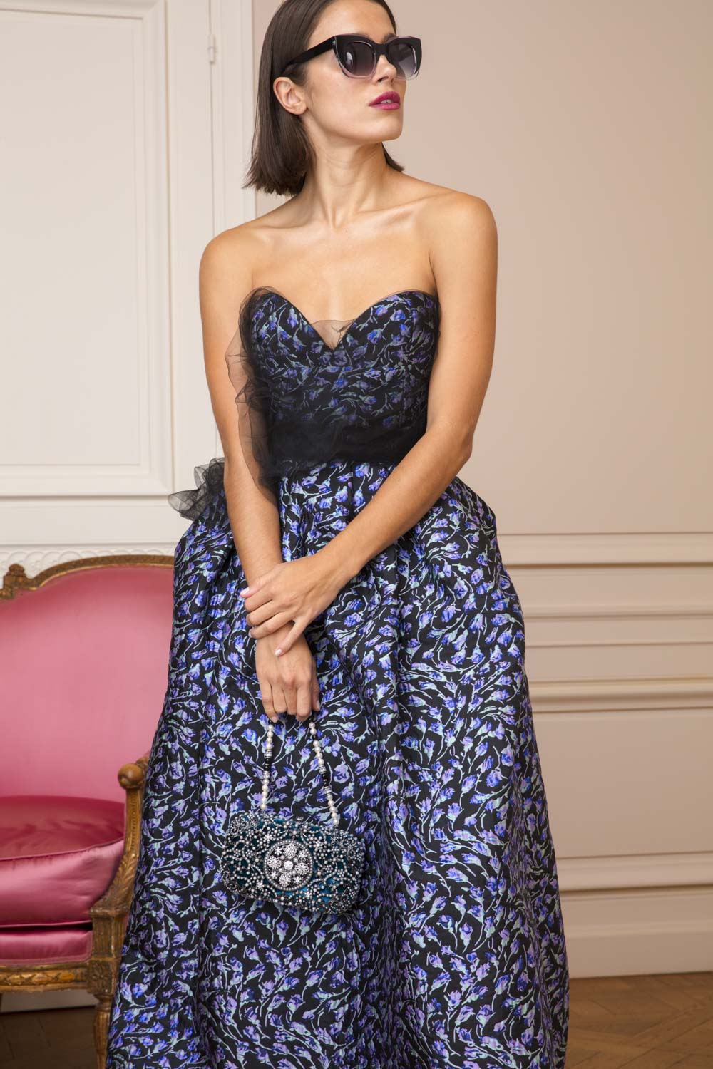 Silk jacquard bustier evening gown with flower print motif and black tulle bodice veil