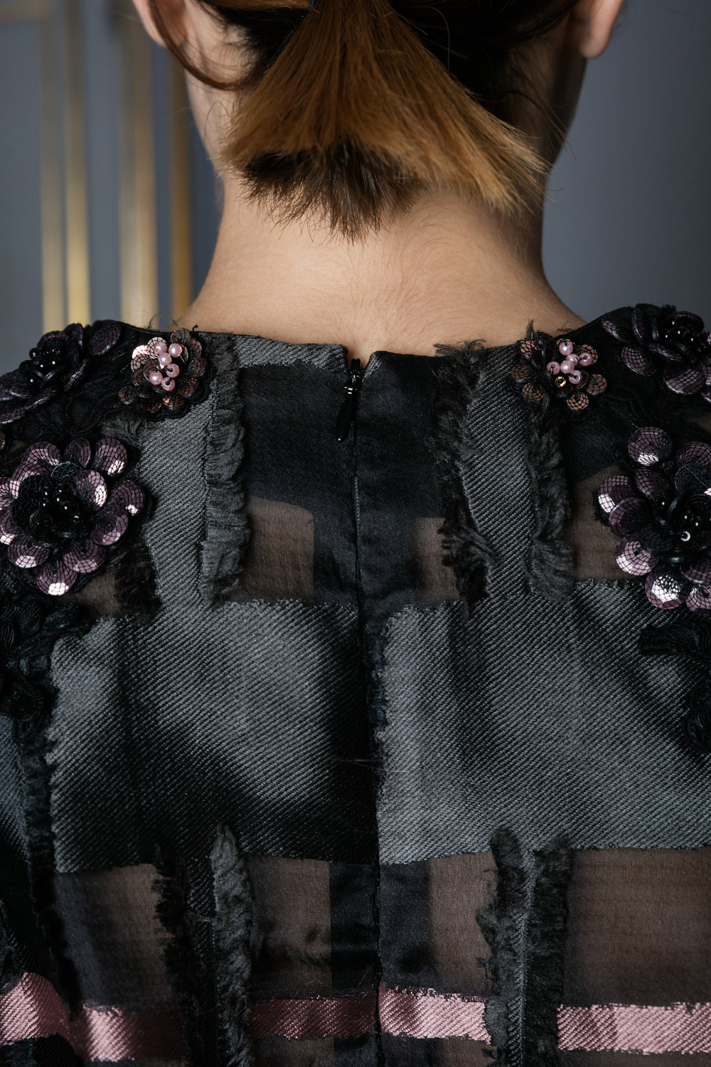 Top with sequin flower shapes