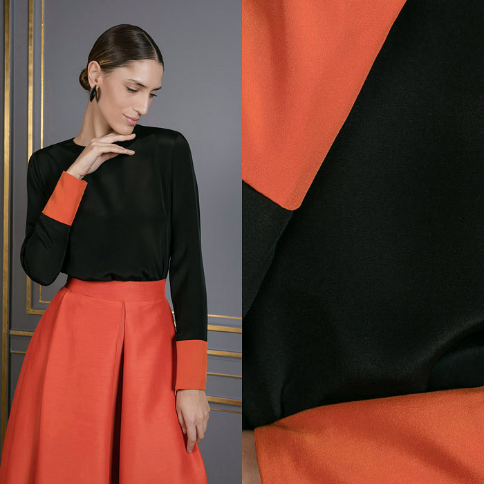 Black silk top with orange cuffs