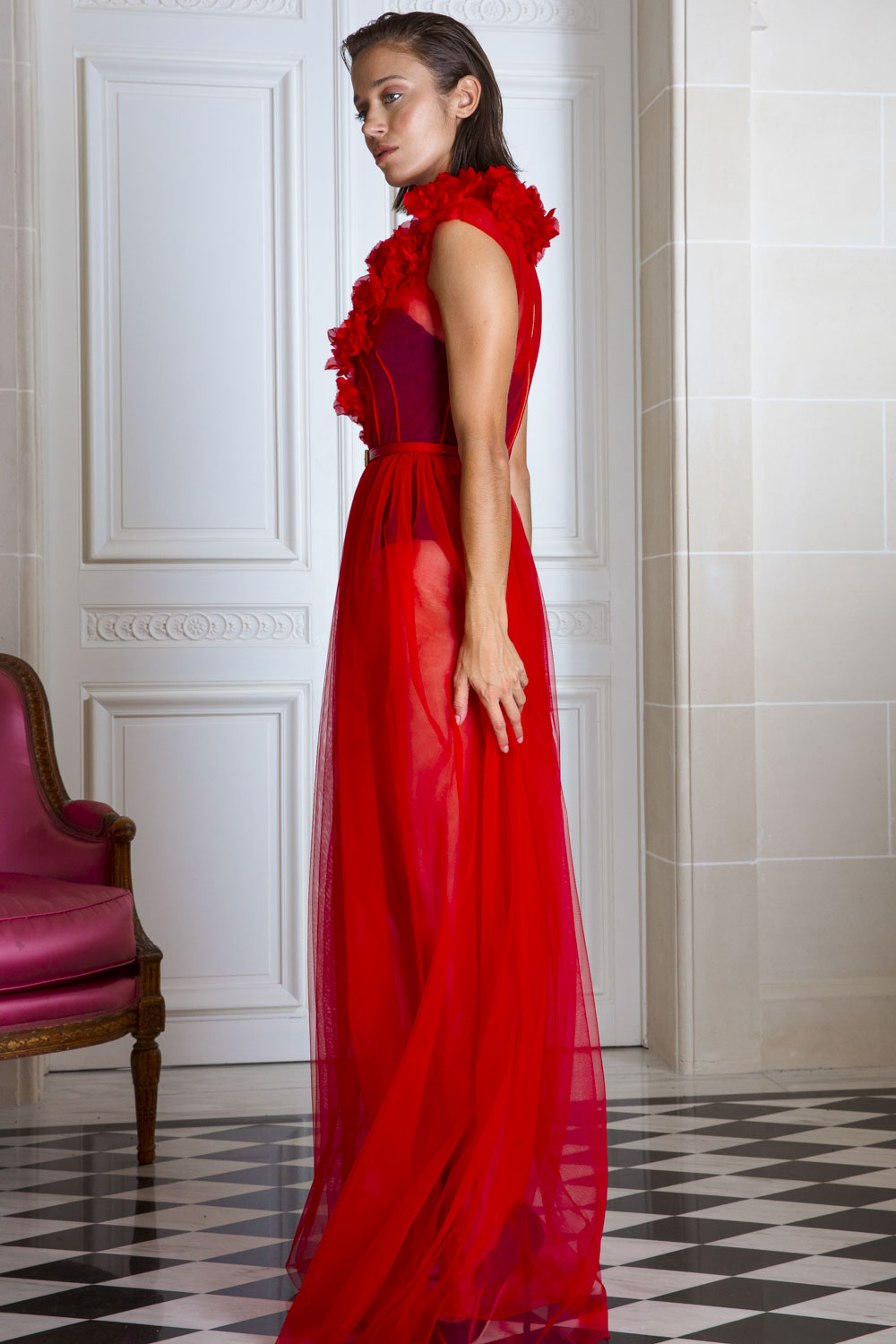 Full length transparent scarlet tulle gown with silk appliqué roses over bodice