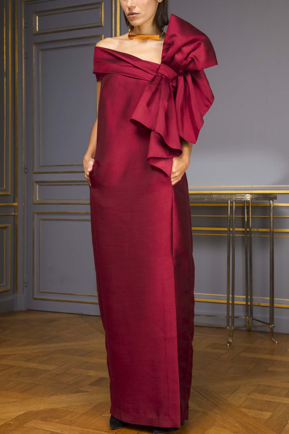 Burgundy silk column evening gown with oversized bow