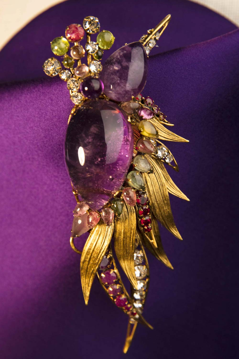 Bird of Paradise brooch, with clear amethysts, tourmaline and golden metal