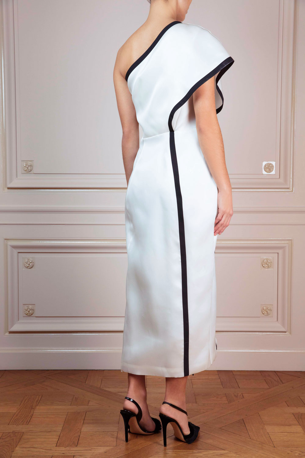 Asymmetric ivory wrapover dress with black ribbon trim