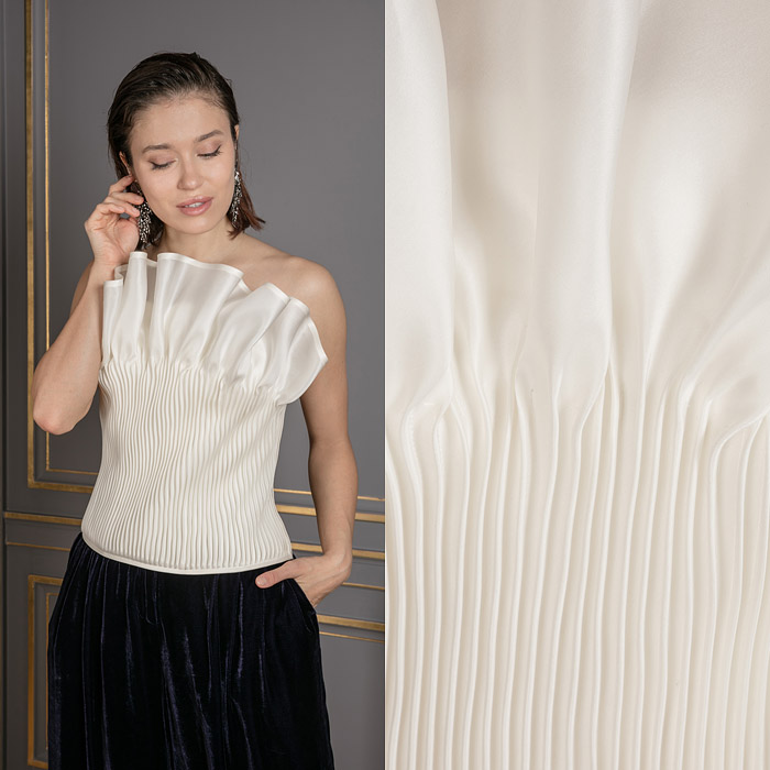 Exclusive asymmetric ivory top